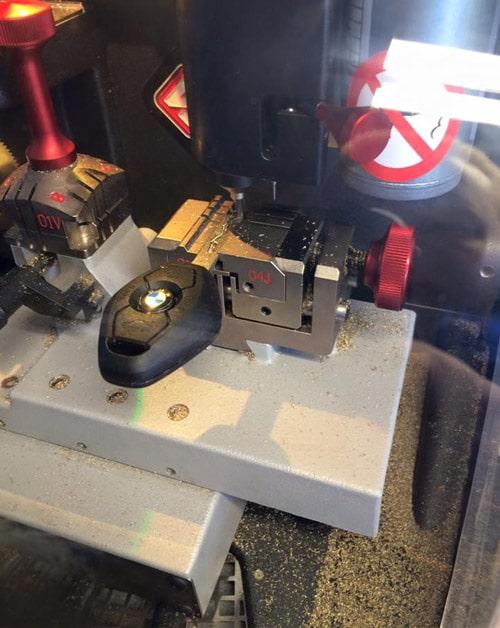 image of a BMW transponder key being cut